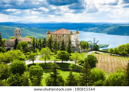 chateau and church in Aiguines and St Croix Lake at background, Var Department, Provence, France - stock photo