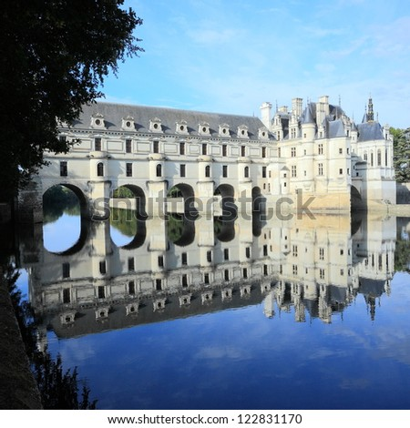 Chateau Chenonceau and peaceful river reflection - stock photo