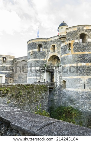 Chateau d'Angers - castle in city of Angers in Loire Valley (department Maine-et-Loire) in France. Castle is located on a rocky ridge overhanging river Maine, founded in 9th century by Counts of Anjou - stock photo