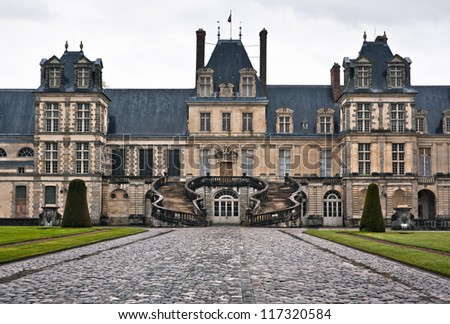 Chateau de Fontainebleau on a rainy day, residence of Napoleon I, Paris, France - stock photo