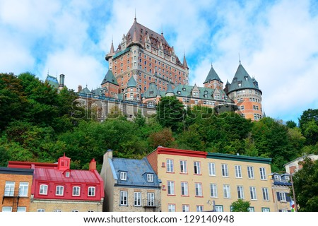 Chateau Frontenac in the day with colorful buildings on street in Quebec City - stock photo