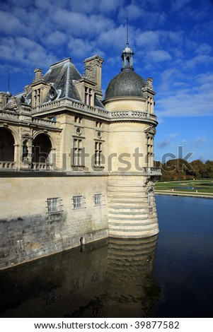 Chateau in Chantilly, France with moat and gothic architecture