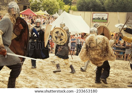 CHATEAUNEUF-DU- PAPE, FRANCE - AUGUST, 03, 2013: Historical Reconstruction of the Medieval Tournament during a free medieval festival held in Chateauneuf-du-Pape, south of France, on summer. - stock photo