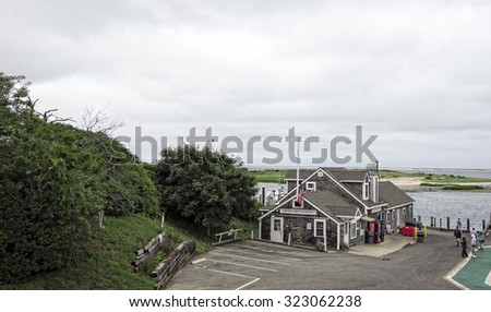 CHATHAM, MASSACHUSETTS - September 11 - The Chatham Pier Fish Market sells and serves fresh seafood and is visited by many who come to watch  the many seals that gather there on September 11, 2015 - stock photo