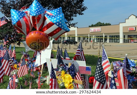 CHATTANOOGA, TN/USA - JULY 18: A makeshift memorial at the Armed Forces Career Center in Chattanooga, TN on July 18, 2015. An attack on the career center was carried out on July 16, 2015. - stock photo