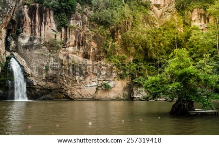 Chattrakan Waterfall in Thailand water fall in deep forest at border of Phitsanulok province Thailand  : soft focus - stock photo