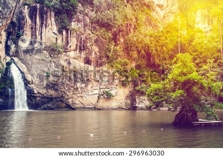 Chattrakan Waterfall in Thailand water fall in deep forest at border of Phitsanulok province Thailand with sun light: soft focus - stock photo