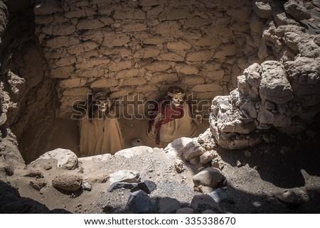 Chauchilla Cemetery with prehispanic mummies in Nazca desert, Peru - stock photo