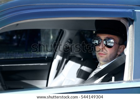 Chauffeur driving a car, closeup