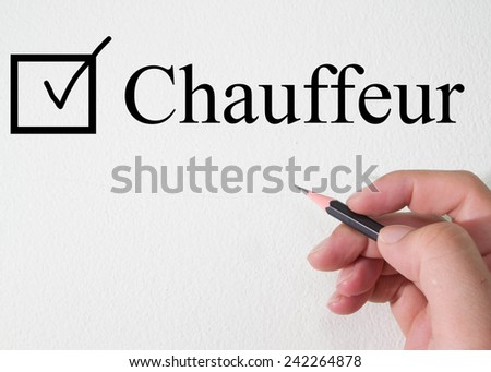 chauffeur text concept on torn paper - stock photo