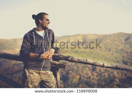 Chearful man enjoying nature view. National Park Fruska Gora, Serbia. - stock photo