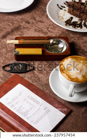 check, ashtray, cigar, lighter and coffee at restaurant table - stock photo