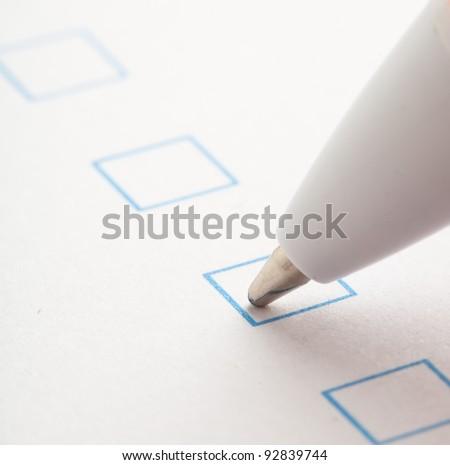 check box of questionnaire, extreme closeup photo - stock photo
