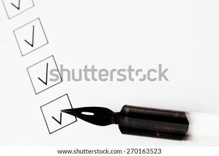 Check boxes and pen isolated on white background