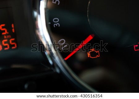 Check engine light. Car dashboard in closeup - stock photo