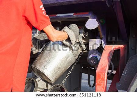 Check fuel truck Drain the oil - stock photo