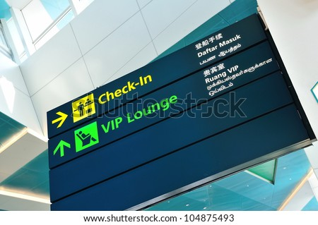 Check-in and VIP lounge signs in Marina Bay Cruise Center Singapore in 4 languages
