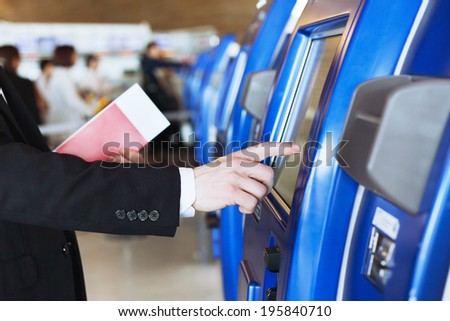 check-in at self help desk in the airport - stock photo