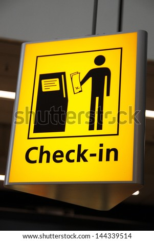Check in sign airport - stock photo