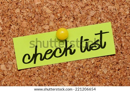 check list word on notepaper - stock photo