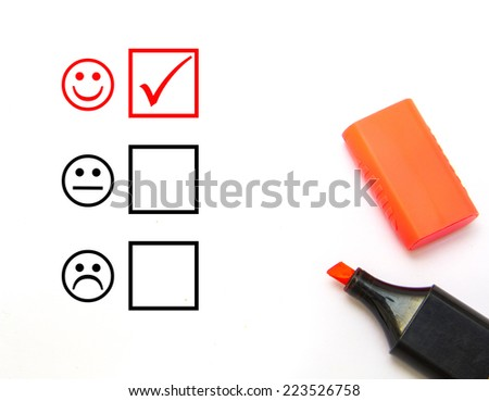 Check mark with red marker on customer service evaluation form - stock photo