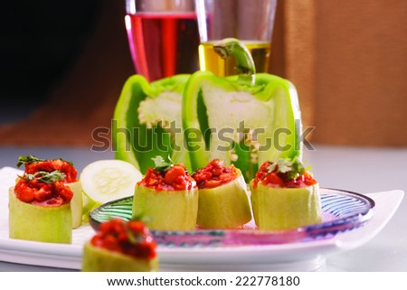 Check out the wonderful combination of cucumber and capsicum and experience the goodness of green! Chill and have fun - stock photo
