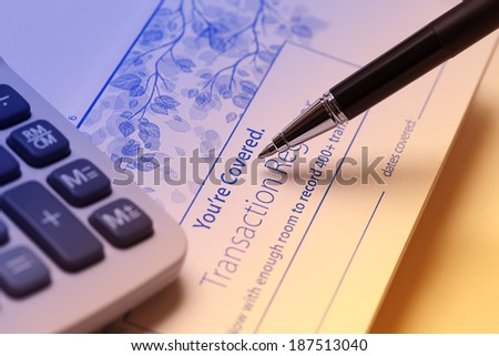 Check Register. A check register is your personal record of your checking account, helps you stay on top of transactions in your account, identify mistakes, catch identity theft, avoid bounced checks - stock photo