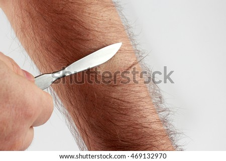 check sharpness sharpening a scalpel on hair