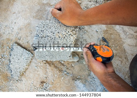 check the horizontal level of house wall layer, made ??of concrete blocks - stock photo