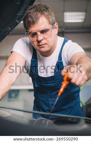 Check the oil level in engine - stock photo