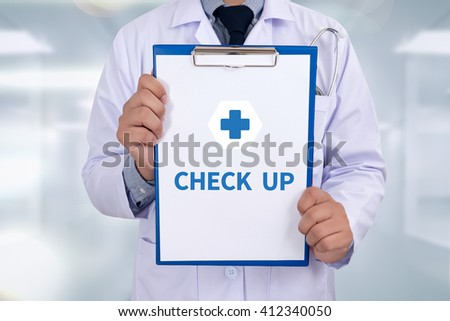 CHECK UP Portrait of a doctor writing a prescription - stock photo