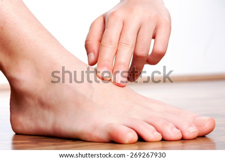 Check your pulse on foot - stock photo
