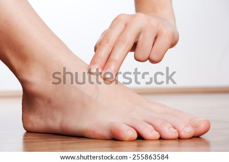 Check your pulse on your foot - stock photo