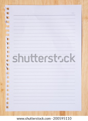 checked note paper on wood