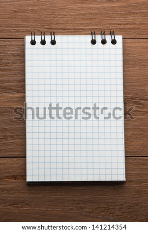 checked paper of on wood background