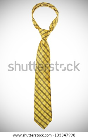 checked yellow tie isolated on white background - stock photo