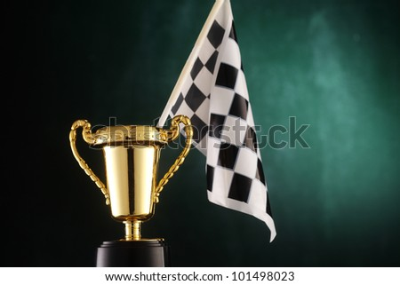 checker flag stands on trophy