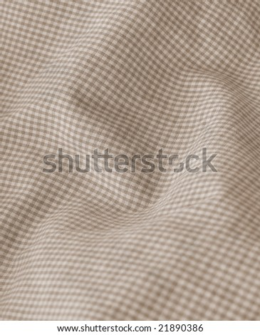 Checkered beige textile background. More of this motif & more fabrics in my port. - stock photo