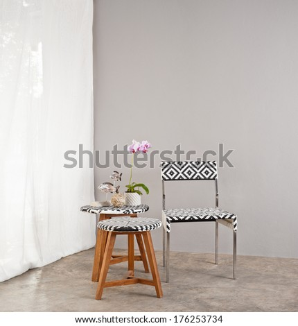 Checkered board garden furniture with small table  - stock photo