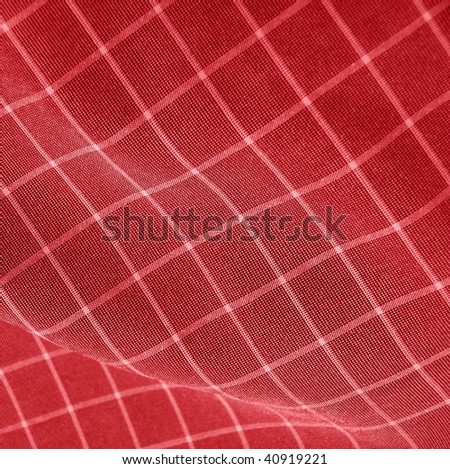 checkered deep red fabric. Ideal for Christmas or interior backgrounds. More of this motif & more fabrics in my port. - stock photo