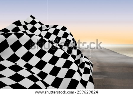 Checkered flag against road