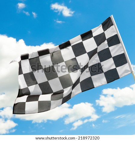 Checkered flag waving in the wind - 1 to 1 ratio - stock photo