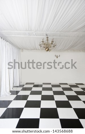 Checkered floor in pop up Marquee - stock photo