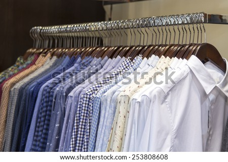 Checkered Mens Shirts on rail in store - stock photo