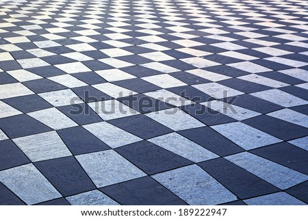 Checkered pattern tiles at Nice city square