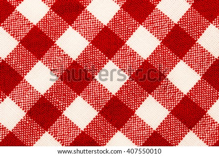 Checkered red white tablecloth background - stock photo