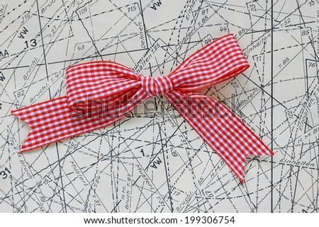 checkered ribbon on sewing pattern  - stock photo