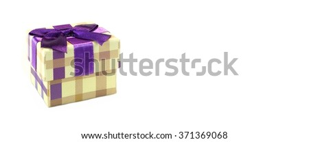 Checkered Single Gift Box With  Beige Brown Pattern, Violet Ribbon And Bow, Isolated On White Background,  Horizontal Image With Copy Space, Front View - stock photo