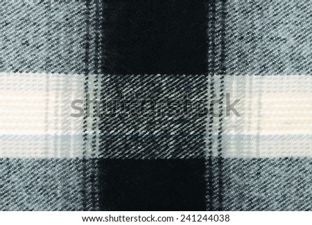 Checkered wool scarf close-up as textured background - stock photo