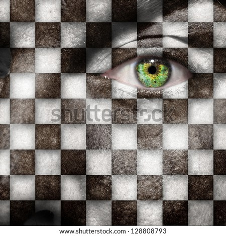 Checkers board or finish flag on male face with green eye
